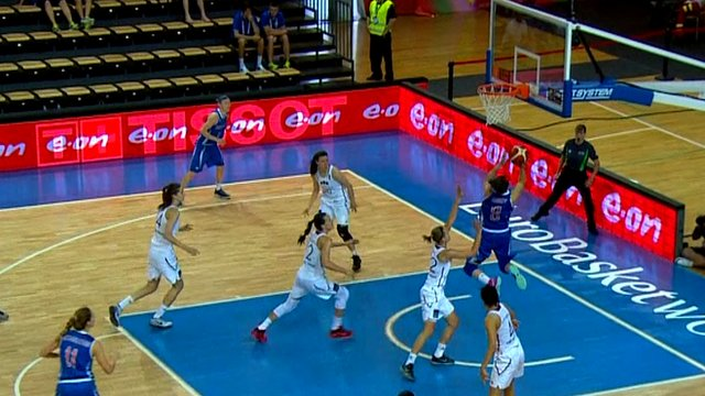 Great Britain score an alley-oop during the 2015 EuroBasket game against Latvia