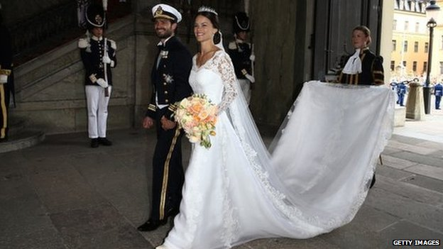 Prince Carl Philip of Sweden is seen with his new wife Princess Sofia of Sweden after their marriage ceremony (13 June 2015)