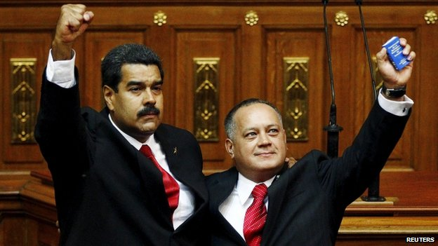 Venezuela's President Nicolas Maduro (L) gestures after being sworn into office by president of the National Assembly Diosdado Cabello (R) in Caracas April 19, 2013. Venezuela's powerful parliamentary chief, Diosdado Cabello, on May 19, 2015