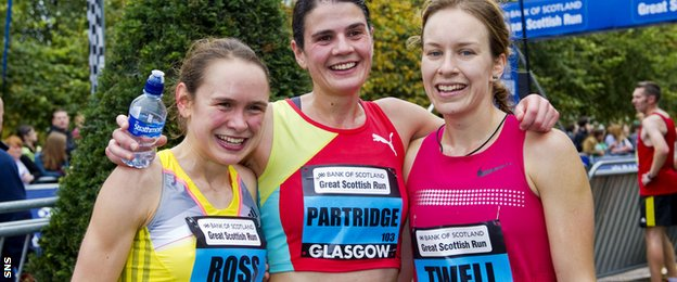Great Scottish Run Half Marathon winner Susan Partridge celebrates with Freya Ross and Steph Twell | Sports Therapy News Surrey