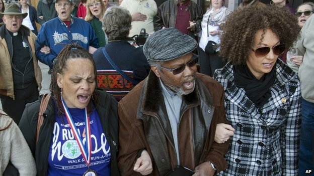 """Rachel Dolezal sings the civil rights anthem """"We Shall Overcome"""" at a rally in March 20156 March 2015"""