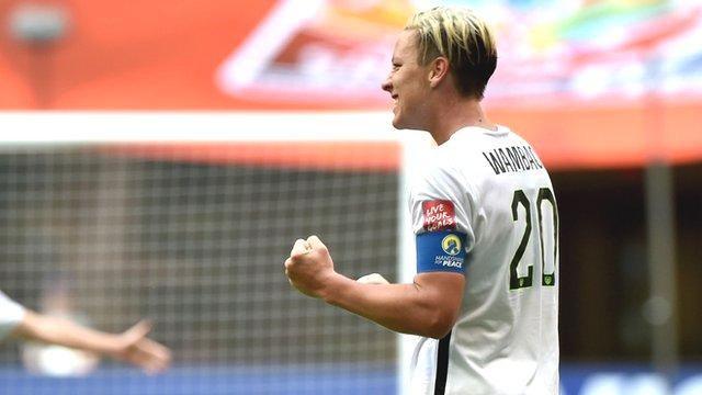 USA's Abby Wambach celebrates after scoring a wonderful volley