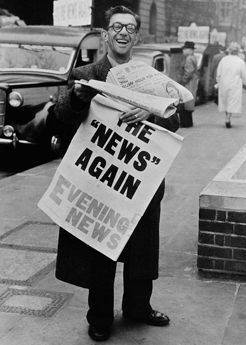 Selling newspapers in London, 1955