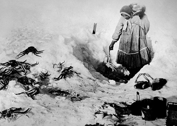 Inuit woman fishes for crabs, Canada, 1924