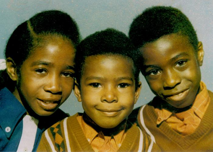 Clive Myrie (r) with siblings, 1970s