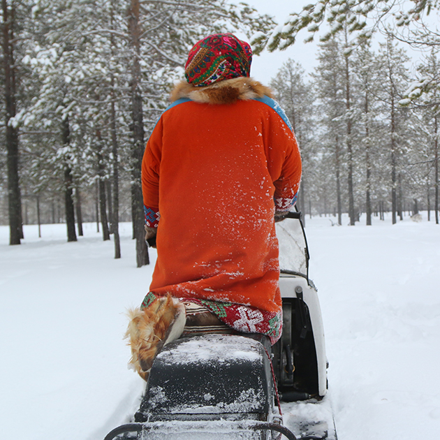 Lubov loves to ride on her snowmobile