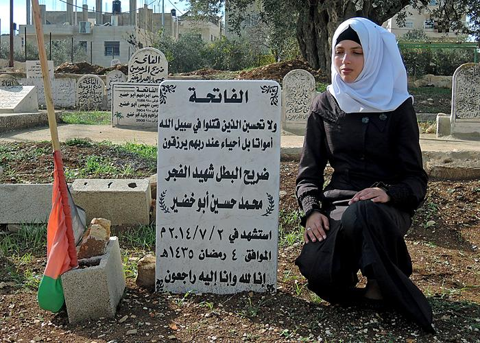Raya Abu Khdeir by her brother's grave