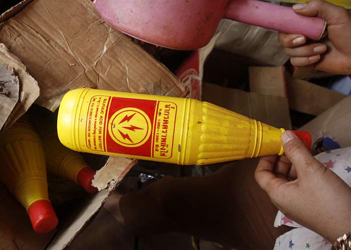 Bottle of acid in Cambodia(photo: AP)