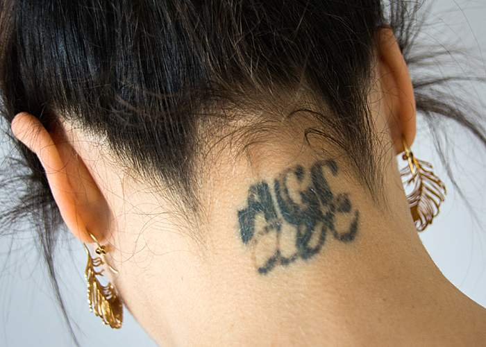 Tass and her brother's initials on her neck