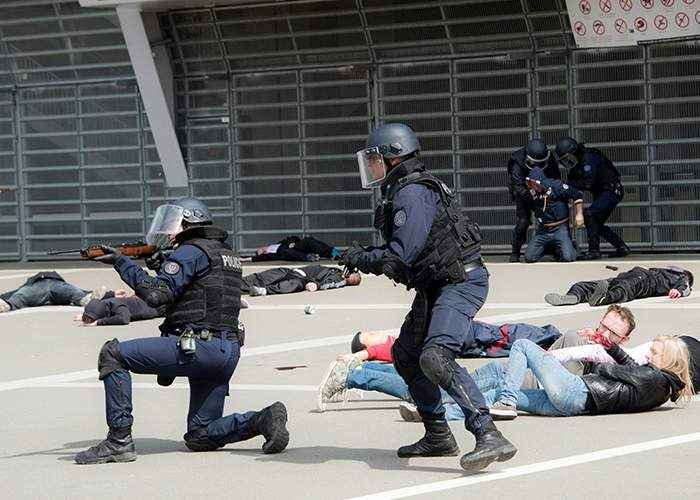Policemen take part in a mock attack exercise before Euro 2016