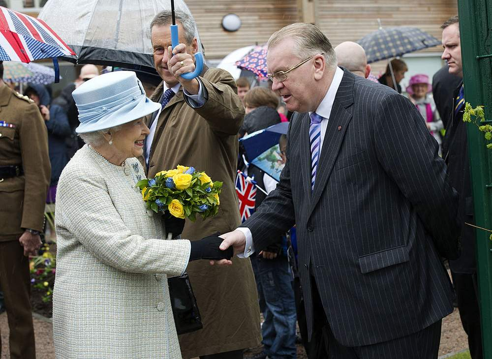 Jeff Edwards and the Queen in 2012 at the opening of Ynysowen Community Primary