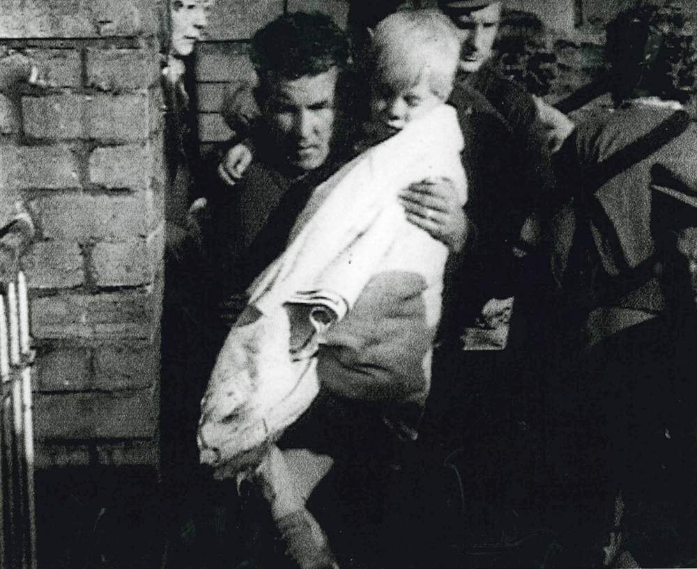 Jeff  carried to safety, his mother close by (top left)
