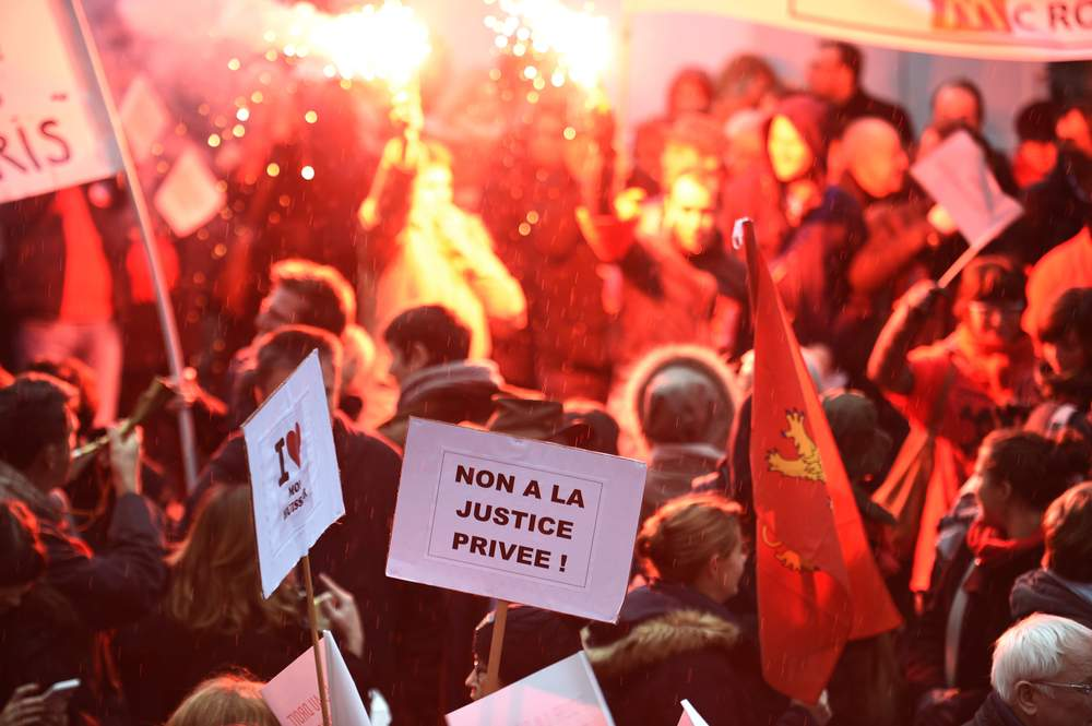 Protesters march against Macron's economic policies, 2015