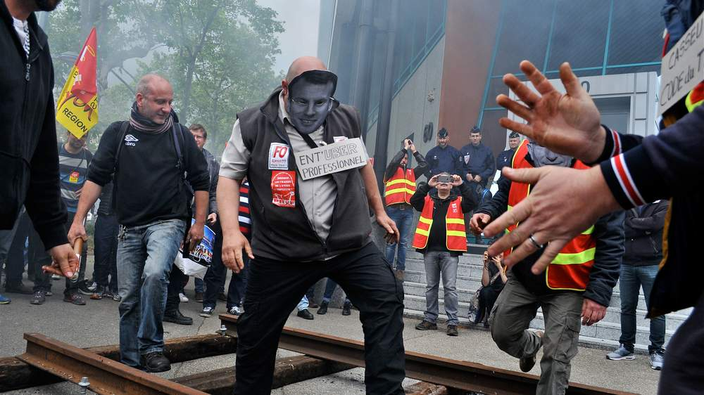French railway workers march to protest against labour laws, June 2016