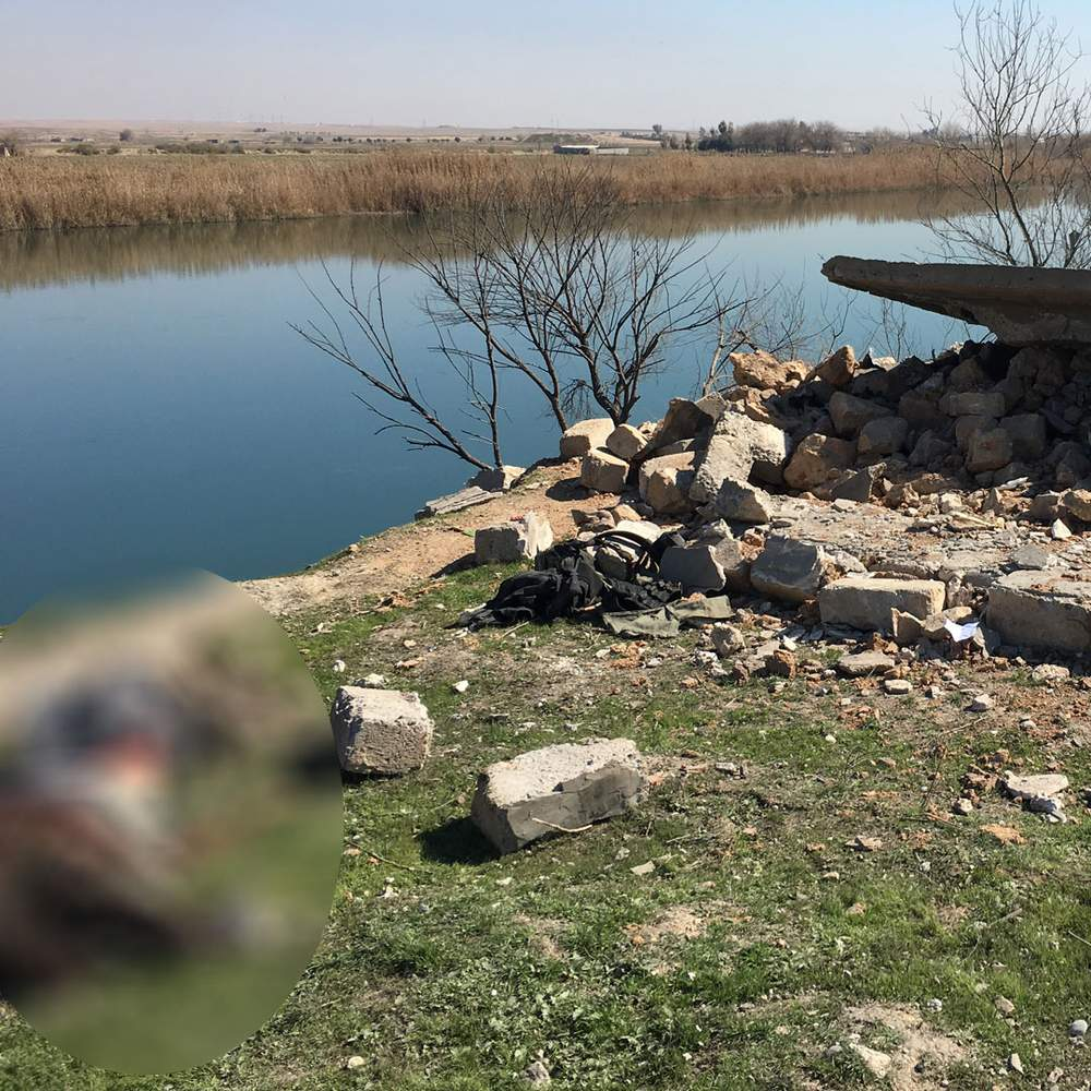 A body and a pile of clothes on the banks of the Tigris