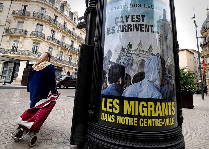 Anti-migrant poster in Beziers, southern France(Getty Images)