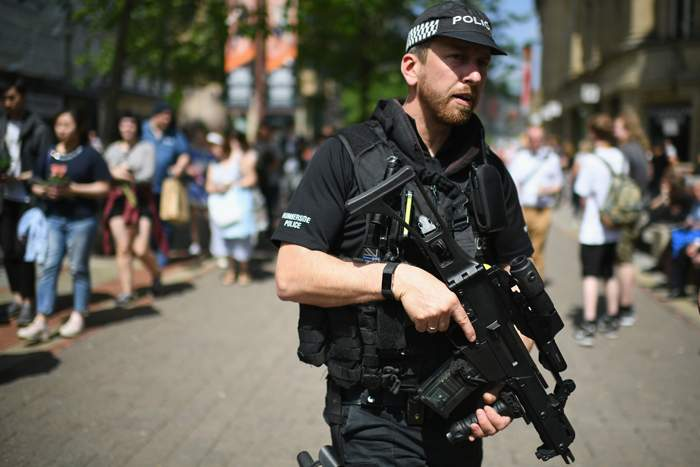 An armed officer on patrol near the site of the Manchester attack