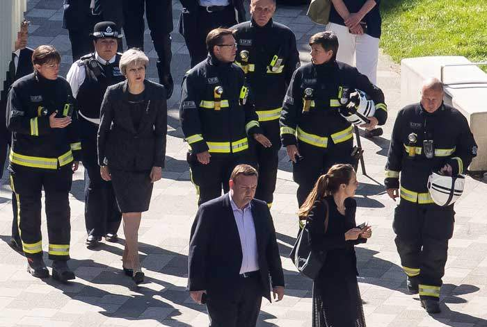 Mrs May drew criticism for an initial visit to Grenfell Tower where she did not meet stricken residents