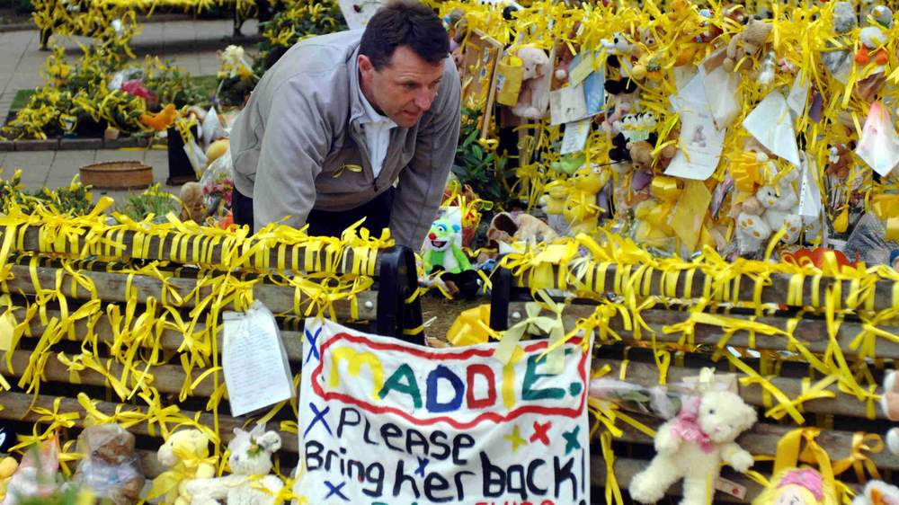 Gerry McCann inspects the tributes in Rothley, Leicestershire