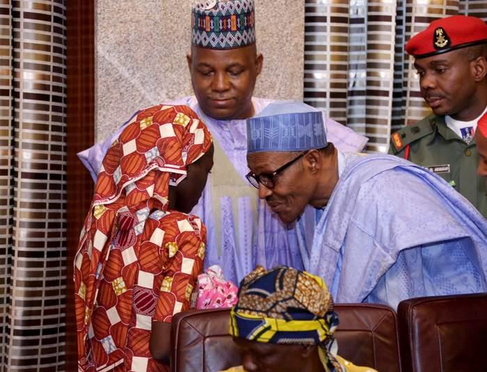 Amina Ali (left) and her baby meet President Buhari