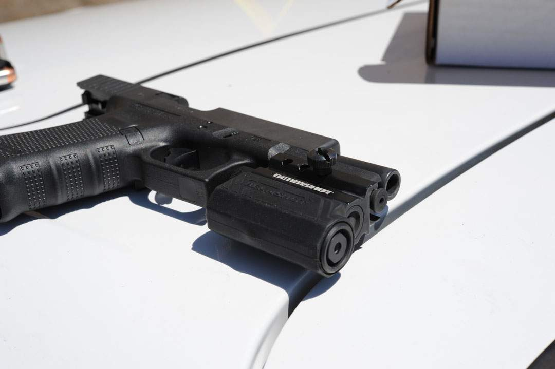 Holmes's Glock 22 Pistol photographed on the bonnet of his car