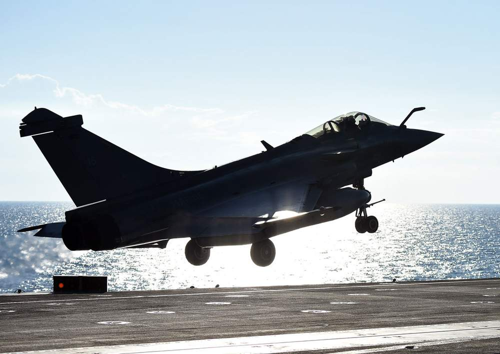 A French jet fighter takes off from an aircraft carrier in November 2015