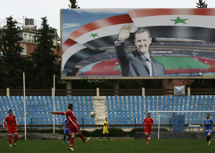 The banner of President Bashar Assad is ever-present at the Tishreen Stadium. Here it is pictured during a game between Latakia's Hutteen and Hama's Taliya in March 2016
