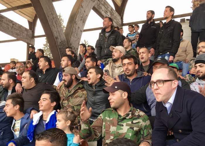 Richard Conway (right) watches the action at the Tishreen Stadium
