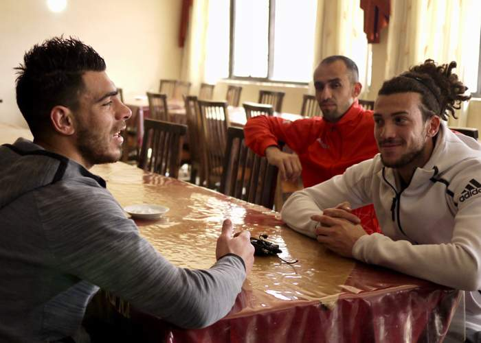 Omar al Midani (right) in conversation with team-mates