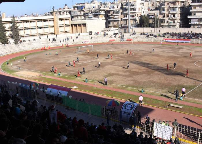 Fans attend the Syrian league football match between Al-Ittihad and Al-Hurriya in January 2017 in the northern Syrian city of Aleppo